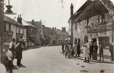 Church Street in about 1932 with Tom Haines, the Market Lavington town crier and Granny Cooper.