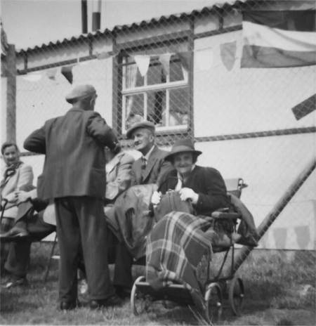 Elsie Cooper (in wheel chair, and her brother Stan next to her at the Market Lavington Coronation celebrations in 1953.