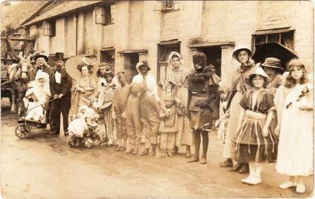 A Market Lavington and Easterton Hospital Week carnival lines up in Easterton - about 1920