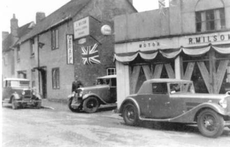 Milsom's Garage on Church Street, Market Lavington - later becoming Edgar Haines garage. John Buckland worked here.