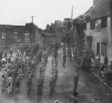 Men and boys on parade in Market Lavington
