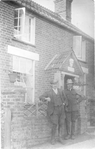 Jubilee Cottage on Northbrook, Market Lavington with Ernest and Arthur oram standing outside