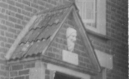 Carved head above the door of Jubille Cottage, Market Lavington