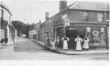 1904 photo of White Street. The staff of Mr Walton's Lavington Supply Store stand outside what is now St. Arbucks, Market Lavington
