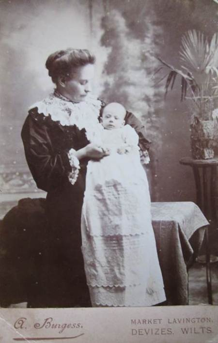 Mrs marion Burgess of 13, High Street, Market Lavington with one of her babies - late 19th century.