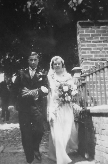 Mr and Mrs Ernest Hill (Mrs Hill was born as Miss Burbidge) leave Market Lavington Church after their 1934 wedding.