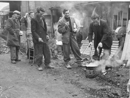 A fry-up for sewer layers in Gye's Yard, Market Lavington in 1958