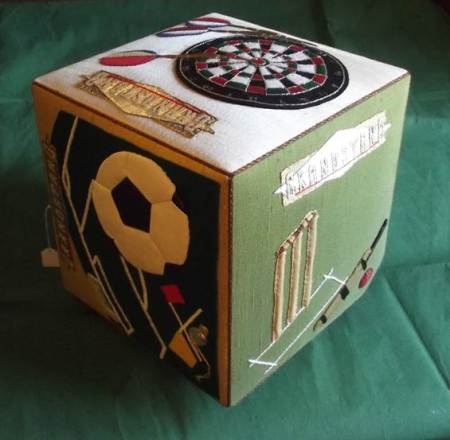 1987 made sports themed cube, produced by members of the Darby and Joan Club in Market Lavington