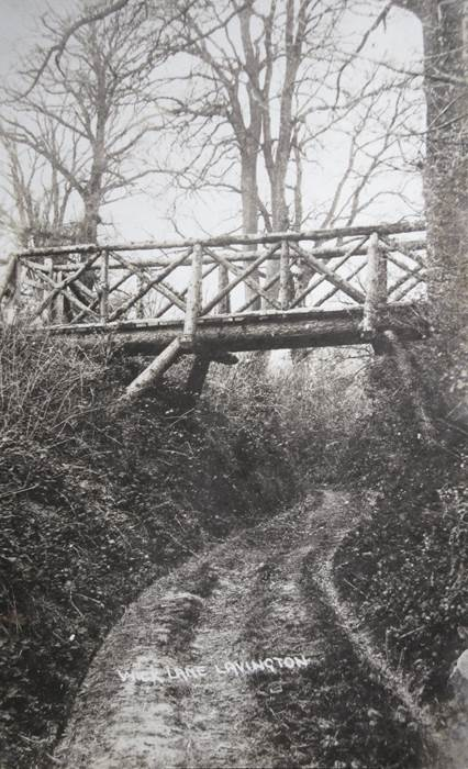 Wick Lane, Market Lavington and a rustic bridge. The photo dates from 1914.