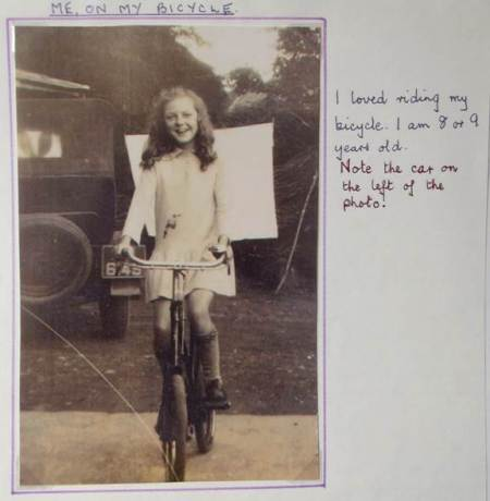Sybil Baker, later Mrs Perry, rides her bicycle in about 1928.