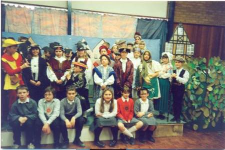 A performance at St Barnabas School in the 1980s. There are lots of people to recognise there.