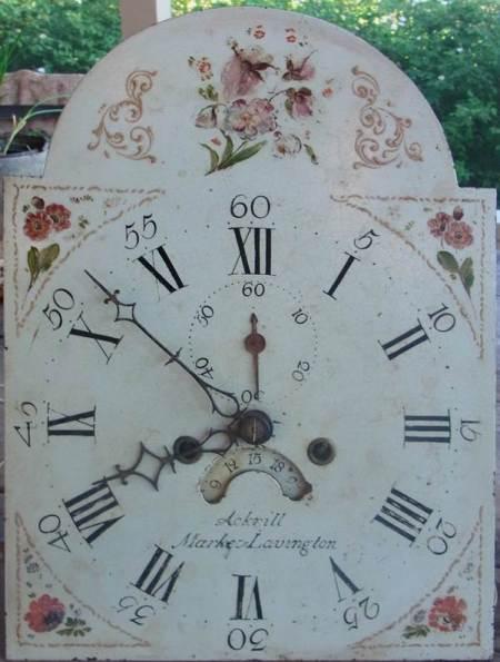 Face of clock by Ackrill of Market Lavington