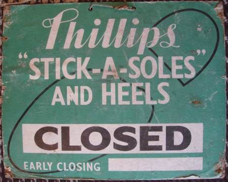 Closed sign from ken Mundy's shoe shop on High Street, Market Lavington