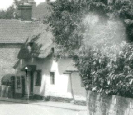 The house by Broadwell was still thatched when this photo was taken