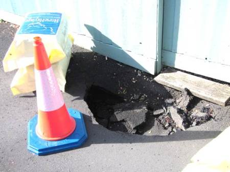 A sink hole in George Mews, Market Lavington in March 2014