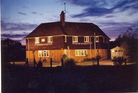 The former cricket pavilion in Market Lavington, floodlit in 1977