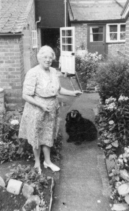 Eleanor Phillips and her dog, Sally in their garden at Church Street, Market Lavington