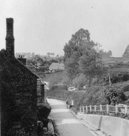 The cottage on the left has gone but new houses mask the view to 'The Rest'