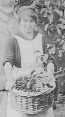 Phyllis Clelford holds the fruit
