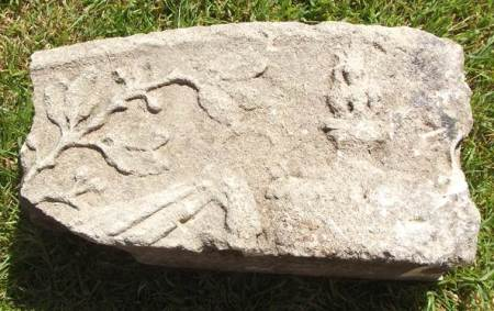 Carved stone dug up just outside market Lavington churchyard, near the Community Hall