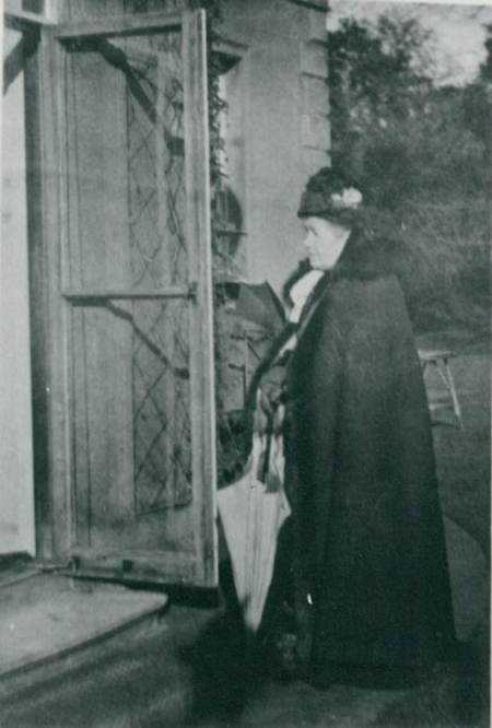 Ann Pleydell Bouverie outside The Old House in the 1930s