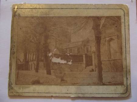 What we have - an old, faded, damaged photo of the church and school in about 1870
