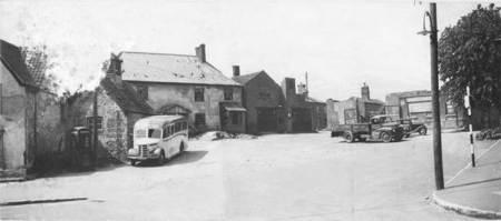 A rather careworn photo shows a malthouse in Market Lavington Market Place