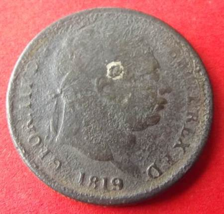 Heads or obverse side of a fake 1819 shilling found in Market Lavington