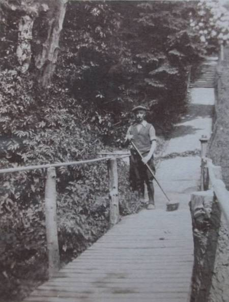 Edwin Potter of market Lavington cleans the path he made to the old Manor House. This path was once known as Potter's Steps.