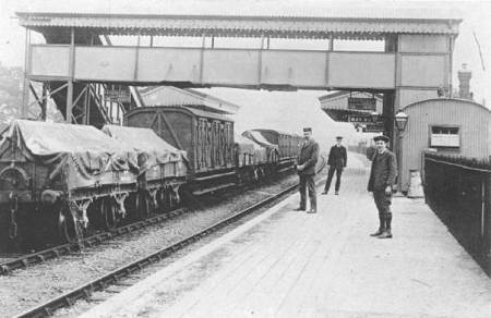 A goods train at Lavington Station in Wiltshire