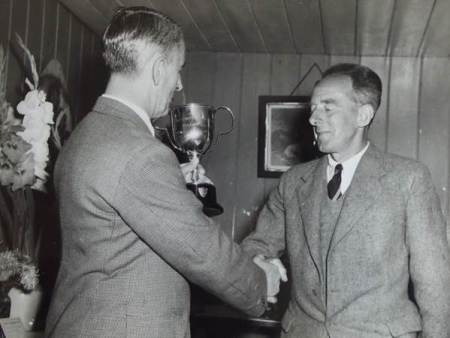 Bill Elisha on the right receives a trophy