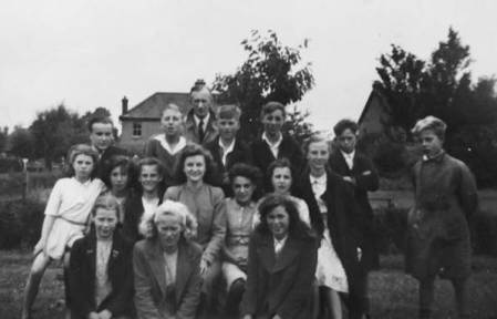 A group of children and teachers pose for the camera