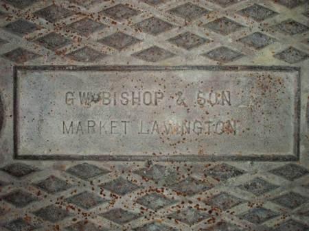 Drain cover badged G W Bishop, Market Lavington