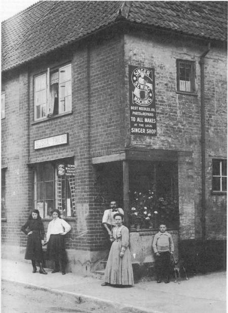 The Elisha family outside their shop in about 1911