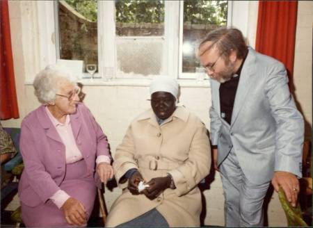 Miss Bond, a visitor from the Sudan and Reverend Ralph Wilkins in 1989