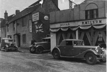 Milsom's Garage, Market Lavington with an interesting collection of cars in 1937