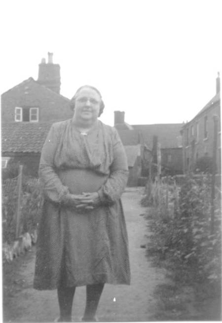 Florence Cooper (née Moore) outside her Market Place home