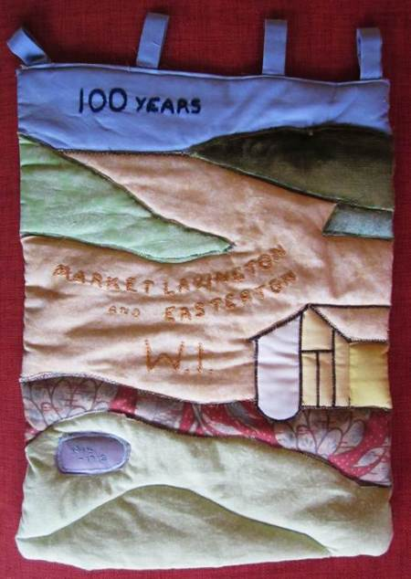 Banner made by Market Lavington and Easterton WI to mark the centenary of the first WI in the UK.