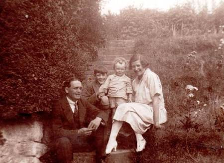 The Godfrey family in the garden at their home - the shop in Easterton. About 1927