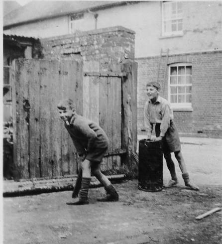 Tom Gye and John King play cricket in Gye's Yard, Market Lavington