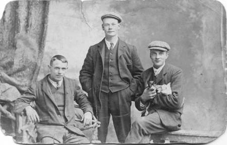 Three men on the front of the card