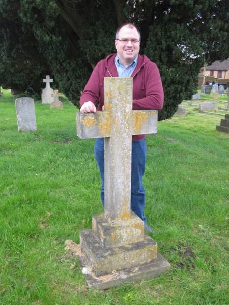 Kristopher Harper of the James Lye Fuchsia Collection stands by the grave of James Lye