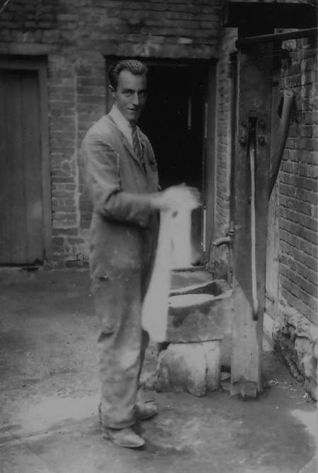 Arthur Cooper uses the Market Place water pump in the 1930s