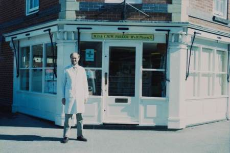 Mr Parker outside his chemist's shop in the year 2000